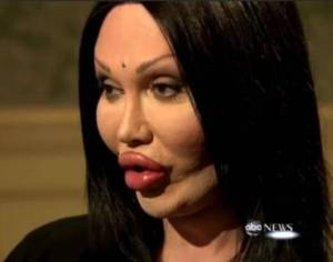 """Pete Burns, lead singer of Dead or Alive sporting a natural evening """"look""""."""