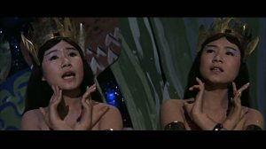 """She's too tossed! Our spells won't work on her. Quick--call Mothra before it's too late!"""