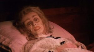 """... her once-grandmotherly face frozen in what appears to be a mask of abject and unrelenting terror."""""""